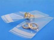Buste trasparenti chiusura c/pattella adesiva cm 8x13+04 pz.100